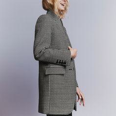 Suited and booted - signature silhouettes see masculine tailoring revamped in new season checks and paired with sculptural zipper-front boots.