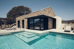 Combining Stone And Black Metal To Create A Contemporary House
