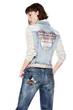 Women's denim jacket with Mickey Mouse embroidery on the back. Knit sleeves and contrasting details. Discover this jacket in more details on Desigual website.