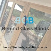 Behind Glass Blinds