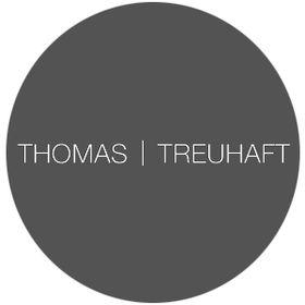 THOMAS | TREUHAFT