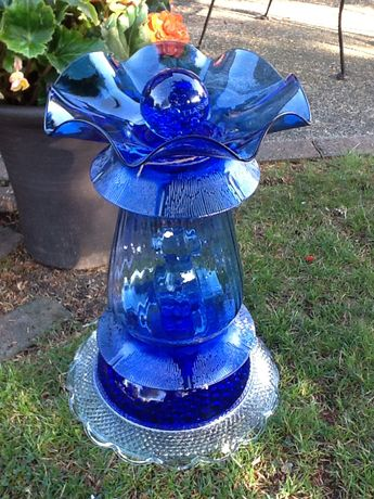 Blue glass birdbath for the garden...great color among the flowers.
