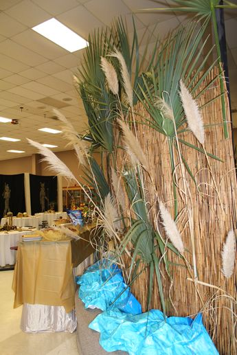 i use this reed fencing from lowes for everything - its creating a backdrop while hiding trash on stage that i did not have time to deal with ... crumbled water print paper serves as the nile river