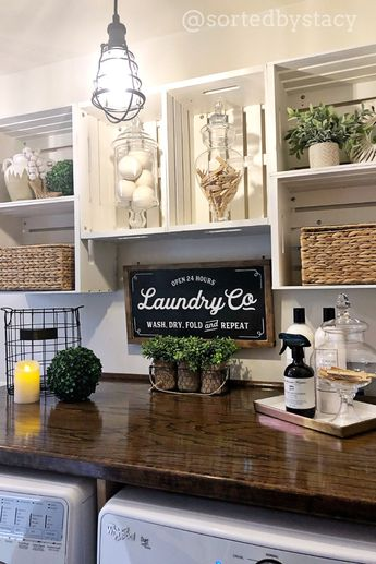 This laundry room for my client was inspired by a pin on Pinterest❤️ She loved the farmhouse look of the crate shelves and decor. Her favorite is the Laundry sign by @huckleberry.ave😊