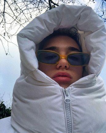 Dua Lipa hiding in a buffer coat is our official winter