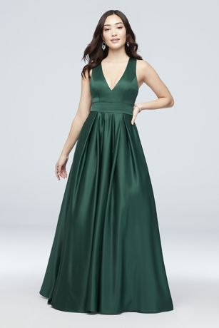 c92c313fffec This traditional satin ball gown gets a modern makeover with a plunging  neckline and a pretty