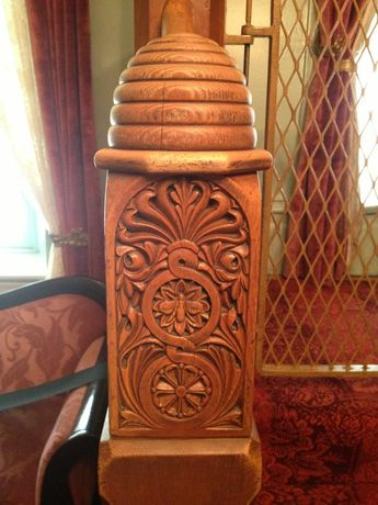 Wooden newel post on banister of interior staircase in Brigham Young's Beehive House in Salt Lake City. The newel post is topped with a carved beehive.