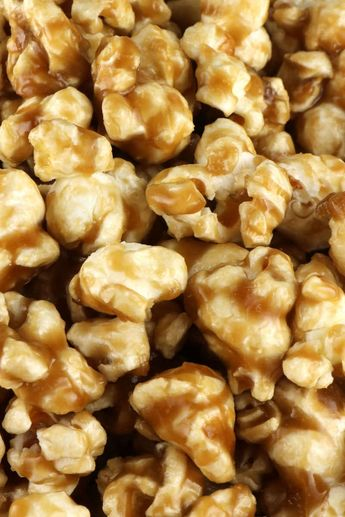 Easy Homemade Caramel Corn - buttery and caramel-y popcorn that tastes just the way it should. And don't worry - no corn syrup needed for this Caramel Popcorn recipe! Your family will ask you to make this popcorn treat again and again. Pin this yummy and easy to make dessert for later and follow us for more great Popcorn Recipes. #Popcorn #CaramelCorn #CaramelPopcorn #SweetPopcorn #PopcornRecipes