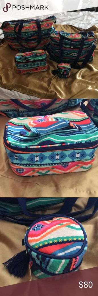 """Aztec Print Travel Bags Four piece travel bags only used once. Large bag 24x25"""". Medium bag 16x14"""". Makeup bag 10x5"""". Jewelry bag 3 1/2x5"""".  Large bag has strap handles 3 pockets in front. Medium bag has strap handles and shoulder straps with large snap pocket  in front. Makeup bag vinyl lined.  Jewelry bag has tassel zipper Buckhead Betties Other"""