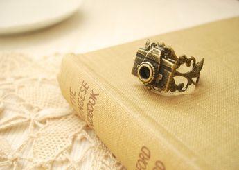 Tiny filigree ring.