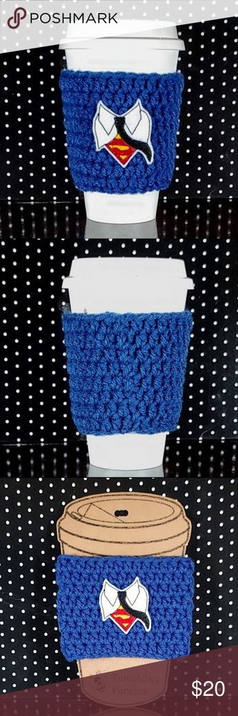 Handmade Coffee Cozy Superman Handmade coffee cozy Superman. For travel cups. Features royal blue acrylic yarn and a white felt shirt collar applique with embroidered black tie and Superman symbol. Handmade by me.  (Travel cup not included.)  **Measurements are approximate** **Colors may vary based on phone settings** **Smoke-free, pet-friendly home** Tumblebee Fancies Kitchen Coffee & Tea Accessories