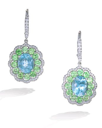 40d583487 Pair of 18 karat white gold drop earrings set with an oval aquamarine  center surrounded by