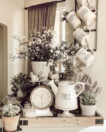 Rustic spring farmhouse decor for the modern country home~ Rae Dunn mugs + watering pitcher are PERFECT for your #spring indoor florals and houseplants. Antique Candle Co. #natural handmade soy candles create the perfect #aromatherapy + atmosphere for the bright spring months - women's gift decorating idea #raedunn PC: CourtneyFitzP01