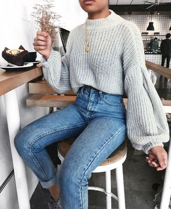 Sweater weather inspo, fall outfit look with Grey knitted sweater and denim jeans.