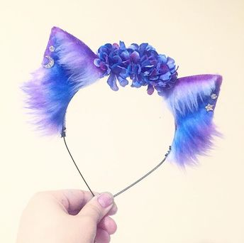 Love this but I could do without the flowers. It's gorgeous and the piercings are a nice touch. KittenKraftShop on Etsy.