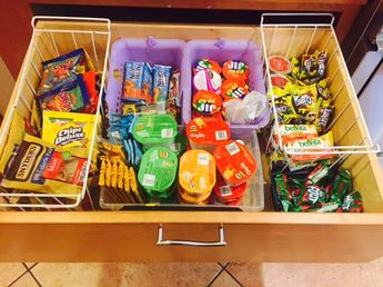 "I use a deep kitchen drawer to organize my kids' school snacks. It eliminates all those boxes that take up space in the cabinets/pantry and it allows them to find their own snacks the night before. These aren't always the most nutritious of snacks so they know that they can choose one from the ""snack drawer"" and two from the frig where I keep cheese sticks, yogurt, cut up fruit, etc."
