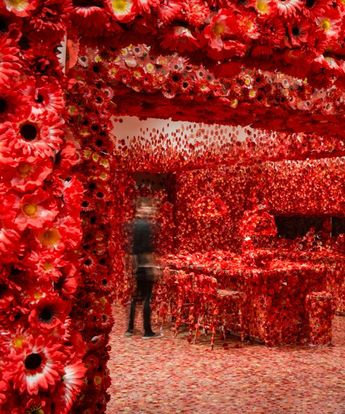 yayoi kusama obliterates a room with a virus of beautiful red flowers