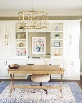 Neutral Office featuring floral painting - C Brooke Ring - Boho chic decor - coastal boho office - preppy office - blue rug - golf chandelier in office - built ins in office - shelf styling