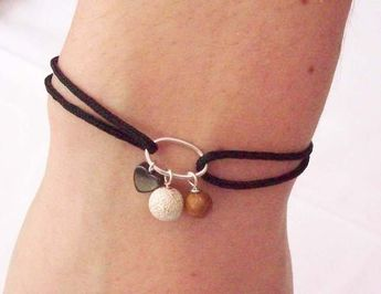 Friendship Bracelet Black with Sterling Silver £12.00 --- maybe do birthstones as a mom or grandma bracelet? Or a wedding gift with bride and groom birthstones?