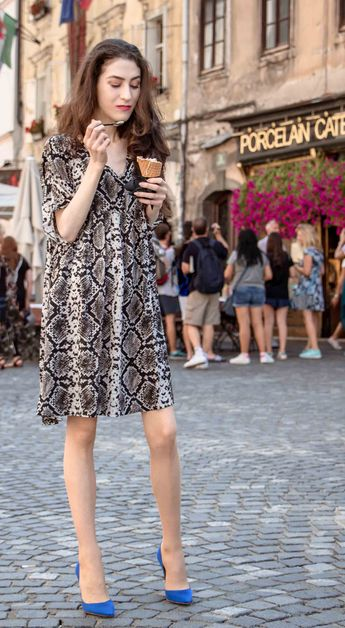 12ca156db8f8 Beautiful Slovenian Fashion Blogger Veronika Lipar of Brunette from Wall  dressed in flowing short snake print