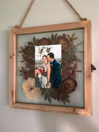 Press flowers from your bouquet in a glass Fran with a wedding photo