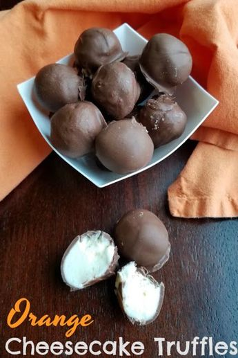 Bites of creamy orange cheesecake goodness are dipped in chocolate to make this one of a kind no bake treat! #sponsored #chocolate #cheesecake #christmassweets #dessertfoodrecipes