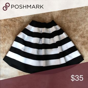 Cute Express Striped Skirt Cute skirt. Worn once.. in excellent condition. Elastic waist band. Hits above the knee. Express Skirts A-Line or Full