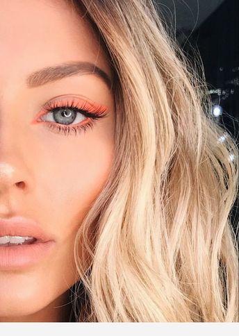 Blonde hair, coral eye makeup