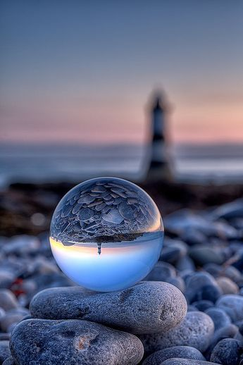 My life was trapped in this beautiful little crystal which had nothing grey in colour but all white and pure but when it broke into pieces one day I faced misery in different shades which no one had ever seen !!!! ˚Spherical Lighthouse