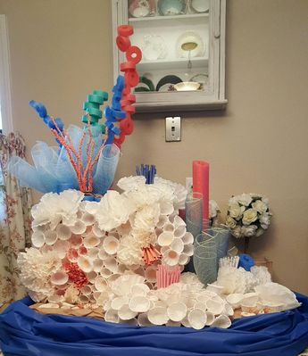 Coral reef from coffee filters, ketchup cups, mesh and pool noodles.