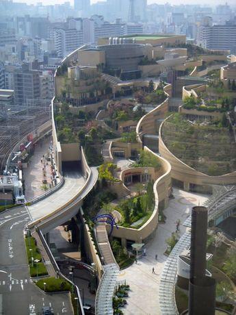 Osaka's Namba Parks flows through urban spaces, making hills of buildings