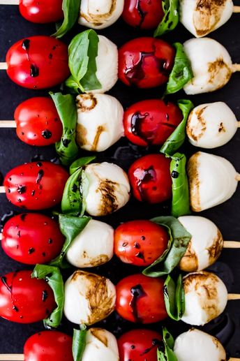 Caprese Skewers are 4 ingredient appetizers that are easy to make but guaranteed to impress! Made with cherry tomatoes, mozzarella, fresh basil, and a simple balsamic reduction, they imitate the classic Caprese salad, only on a skewer!
