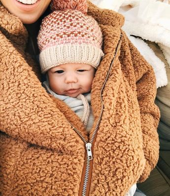 All bundled up with baby