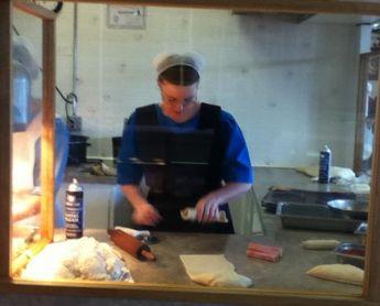 hman: Here is an Amish woman making hot dog pretzels (pretzel hot dogs?).