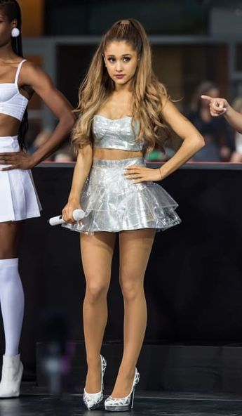 Here's a picture of the young pop star queen Ariana Grande performing in NYC last week.