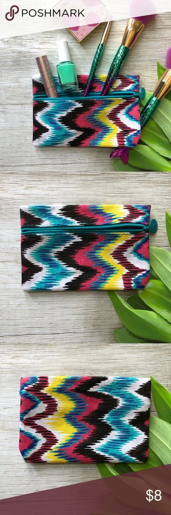 Tribal Pattern Makeup Bag NWOT Cute makeup bag that has room to hold plenty of your everyday essentials. Bright and fun, this bag has an ikat tribal pattern.  Has a blue inner lining and a zip enclosure.   Perfect to use as a gift bag for the upcoming holidays or that little gift for someone.   Please ask questions and happy poshing Bags Cosmetic Bags & Cases