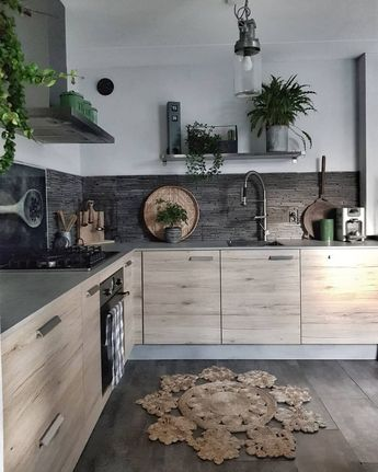 Nice tiling for the splashback Nice use of plants with grey background