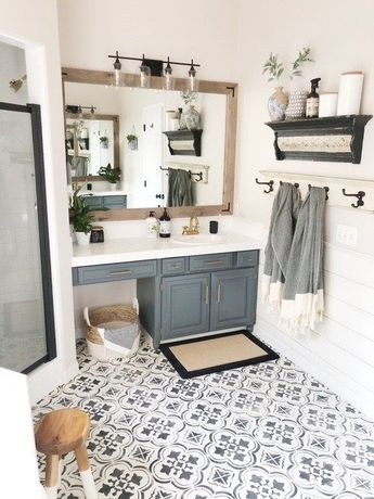DIY Master Bathroom Updates     #DIYbathroom #stenciledfloors #framedbathroommirror #paintedcabinets #bathroom