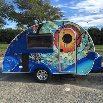 """Isn't this just so cool??!! I was so thrilled to see the finished design wrapped on my collectors Teardrop Trailer using the painting """"Blue Essence""""©. It is amazingly well done and I wish I could see it in person, it's beautiful!"""