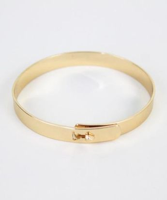 Go back to basics with this simple golden bracelet. $22 www.mooreaseal.com