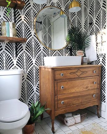 Pattern wallpaper in powder room bathroom, black and white wallpaper in farmhouse style bathroom with vintage dresser as vanity and vessel sink