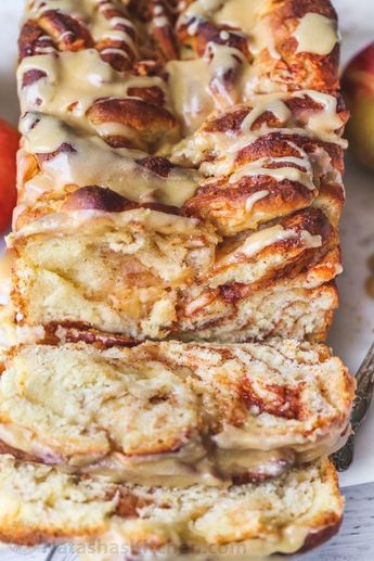 Pull-apart apple bread loaf recipe. A sweet bread loaf with a cinnamon and fresh apple filling with a phenomenal glaze. #pullapartbread #applebread #appleloaf #applerecipes #recipes