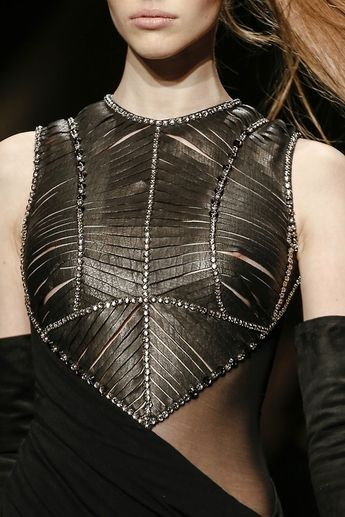 Bodice detail - dress with interesting mix of opacity, contrasting materials and armour-like bodice structure; closeup fashion // Donna Karan FW13