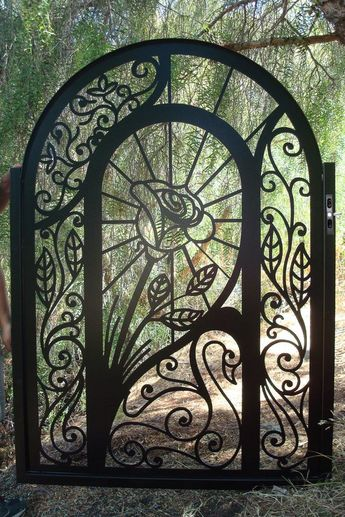 Create an elegant entry way for your home! Here is a fabulous custom fabricated garden/entry gate with beautiful detail. A lovely rose and swan are the centerpiece of this metal art gate. Lines around the rose project upward with an energetic flow. This is a gate you can enjoy for