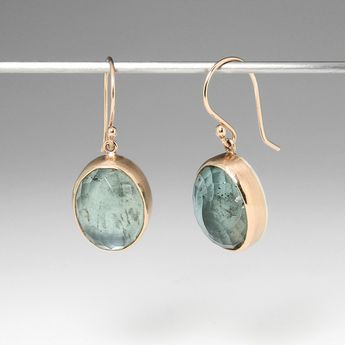 """A pair of sterling silver and 14k yellow gold earrings with moss aquamarine stones. Total length measures 1"""" by Jamie Joseph."""