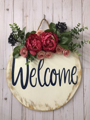 A door hanger is a great way to add decor to your front porch. #doorhangers #farmhousestyle #welcomesign