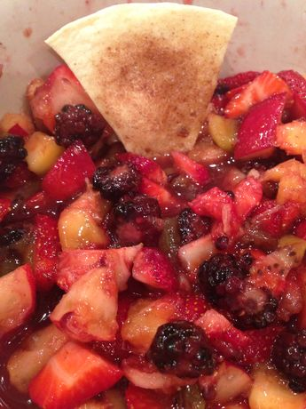 Cinnamon chips with fruit salsa For salsa: 2 kiwis, peeled, diced. 3 peaches, diced. 8 oz blackberries. 16 oz strawberries, diced. 2 T white sugar. 1 T brown sugar. 2 T fruit preserves, any flavor For chips:  10 (10 inch) flour tortillas. melted butter. 1 cup white sugar. 2 tbsp cinnamon Instructions: 1. Mix all ingredients for fruit salsa. Cover and chill while the oven preheats to 350. 2. Coat 1 side of tortillas with butter. Sprinkle with cinnamon sugar, cut into wedges. 3. Bake 8-10 mins.