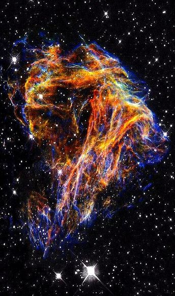 Celestial Fireworks - Hubble by Deep Space Photography - Resembling the puffs of smoke and sparks from a summer fireworks display in this image from NASA's Hubble Space Telescope, these delicate filaments are actually sheets of debris from a stellar...