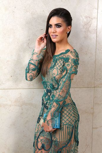 Camila Coelho wearing a green embellished Party dress.