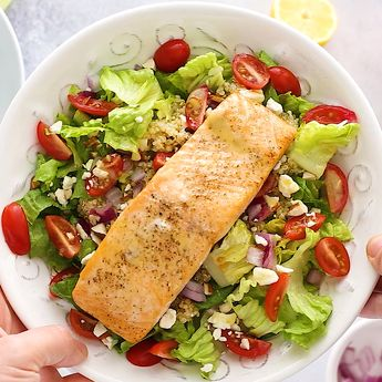 This Mediterranean salmon salad is loaded with flavor, incredibly healthy and gluten-free. Packed with tomatoes, quinoa, red onion, feta, almonds, and dressed with a lemon vinaigrette. #salad #salmon #salmonrecipes